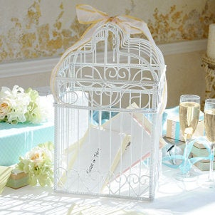Bird cages to hold gift cards and envelopes are beautiful wedding decorations