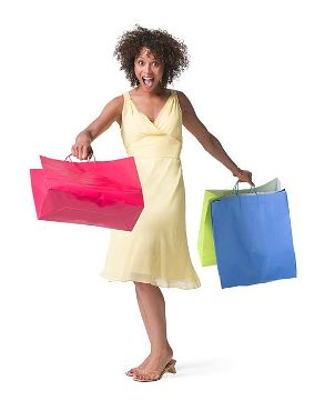 Woman with shopping bags in a flattering dress