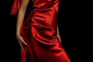 Woman wearing a red satin dress for Valentine's Day