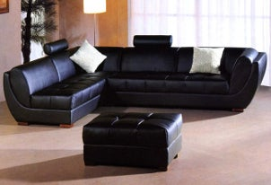 Living room decorated with black, leather furniture