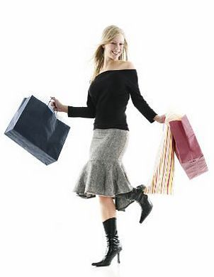 Woman wearing a skirt and carrying shopping bags