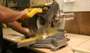 Man using electric miter saw