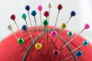 Pins in a pincushion