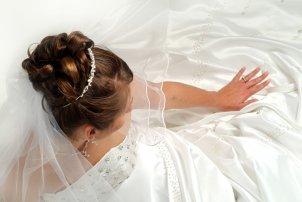 A bride admiring her diamond wedding ring