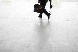 Businessman carrying a laptop briefcase