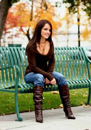 Fashionable girl on park bench