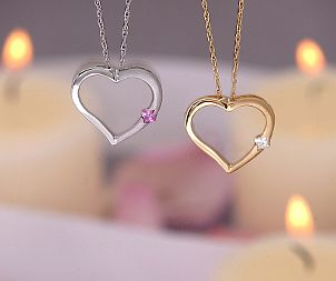 A white gold heart pendant and a yellow gold heart pendant