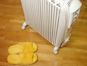 White space heater warms up bedroom and fuzzy slippers