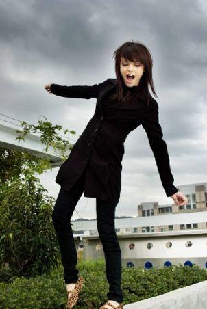 Teen girl wearing a long coat