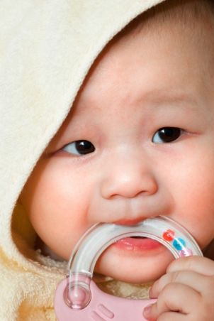Baby chewing a teething ring