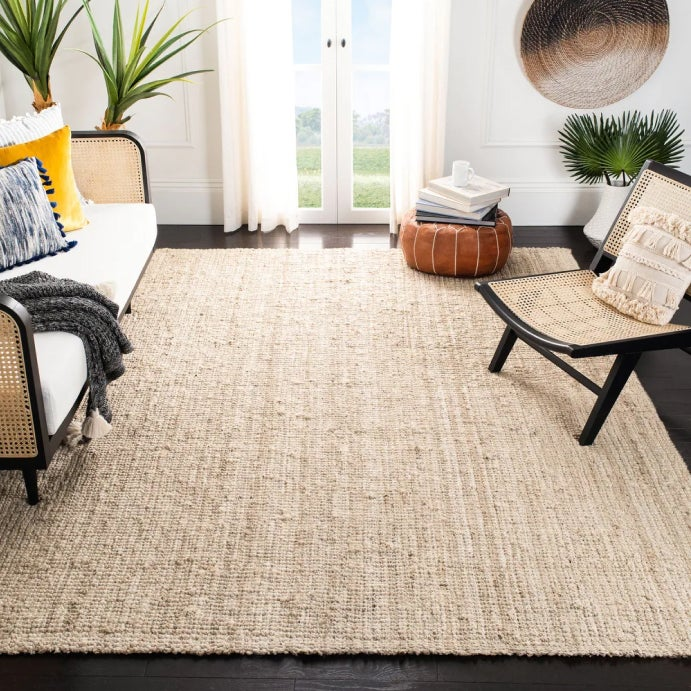 An showcase with an ornate oriental rug unrolled beneath other rugs and a moroccan furniture available online at Overstock