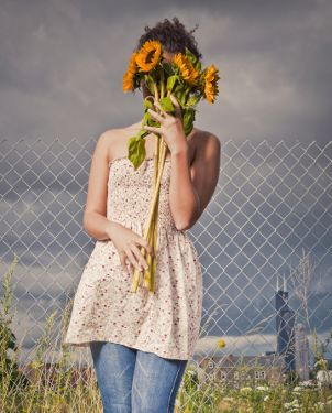 Young woman with flowers over her face