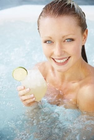 Young woman soaks in portable hot tub