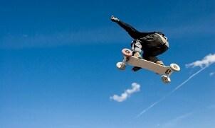 Man riding a mountain board