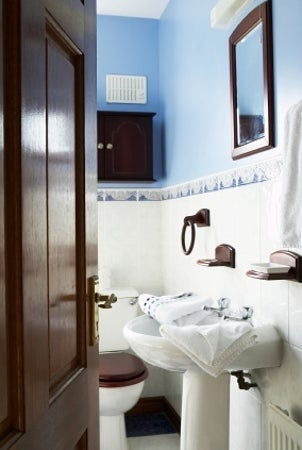 Blue and white bathroom with a pedestal sink