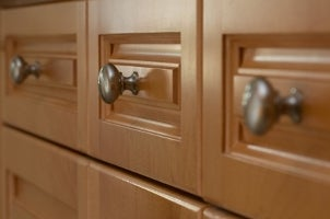 Things You Need: Power Drill; Cabinet Handles