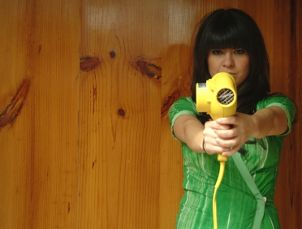 Woman holding yellow blow dryer