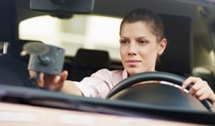 Woman using a car GPS