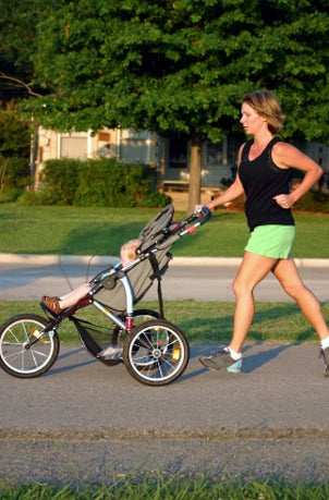 Woman running with jogging stroller