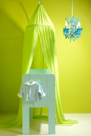 Blue baby bassinet with green canopy and blue chandelier