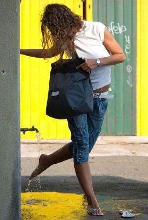 Woman wearing a Raymond Weil watch on the street