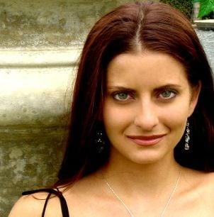 A pretty woman wearing crystal drop earrings