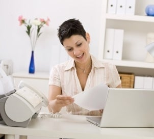 Woman reviewing documents from an inkjet printer