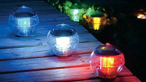 Garden and patio are complemented by outdoor lights