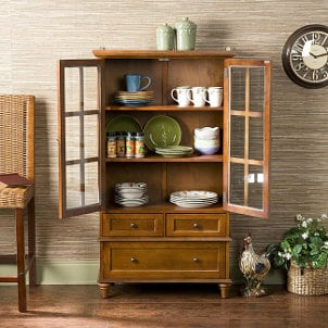 Wooden china cabinet full of dishes