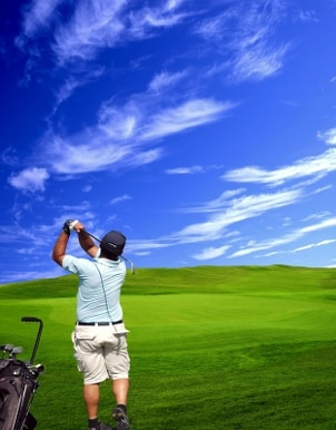 Golfer watching his drive