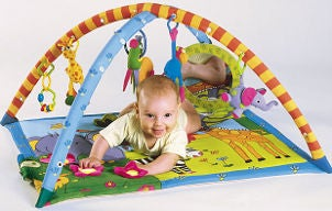 Baby plays with his playmat