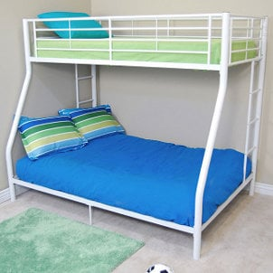 White metal kid's bunkbed bright green and blue blankets and pillows