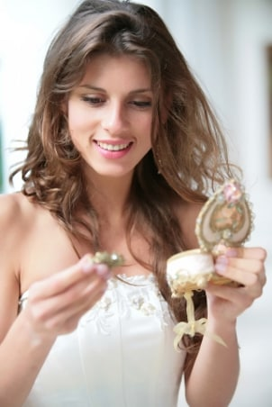 Lovely young woman looks at her new brooch