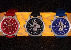 Three colorful wristwatches in blue, red and black