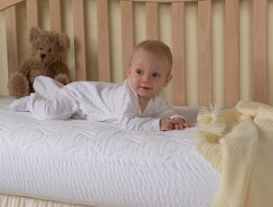 Happy baby in a crib