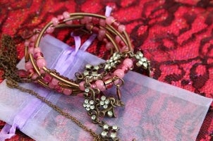 A stack of copper beaded bracelets and crystal flower bracelets