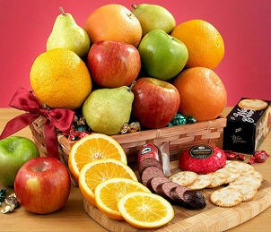 Delicious food gift basket full of fruit and cheese