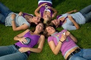 Girls listening to music with portable MP3 players
