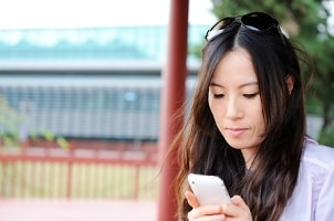 Girl downloading apps to her iPhone