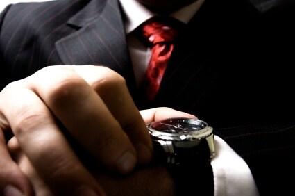Man checks the time on his Stuhrling Original watch
