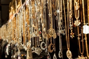 A long row of pendants hanging on chains