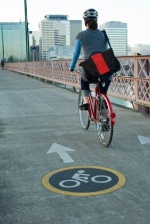 City girl riding a road bike