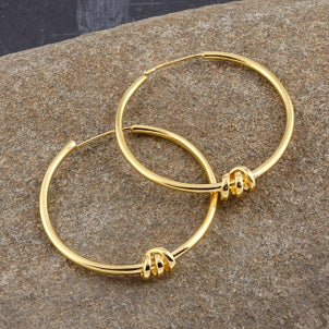 Beautiful unique yellow gold hoop earrings with twisted knot embellishments