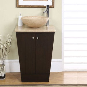 Auburn marble vessel sink on a brown vanity