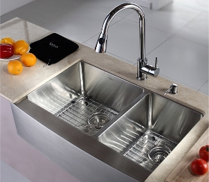 Stainless steel kitchen sink in a marble countertop