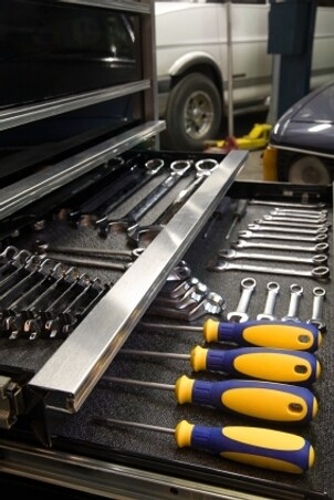 Garage tool organizer full of auto tools