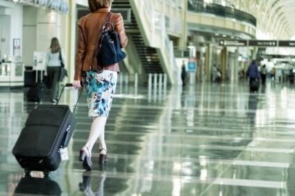 A traveler loving her luggage