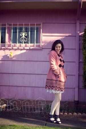 Woman wearing a pink wool coat