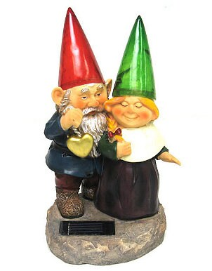 Two snuggling garden gnomes used as a path light