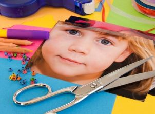 Scissors and photos are two essential scrapbooking supplies